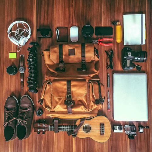 Gear and gadgets of a hip young photographer; high angle view