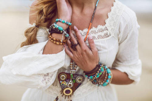 Boho woman with multicolored jewelry